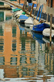 Boats line a Venice canal — Stock Photo