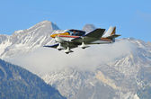 Sports aircraft in the mountains — Stock Photo