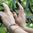Stock Photo: Young girl's hands, resting on old rusted gate