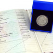 "Silver medal ""for outstanding achievements in teaching"" in box with red certificate — Stock Photo #13902155"