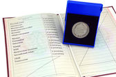 "Silver medal ""for outstanding achievements in teaching"" in a box with a red certificate — Stock Photo"