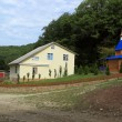 A building with a chapel at the horse farm in the town of Plyaho - Yellow Snake Valley. Tuapse district, Krasnodar Krai, Russia. - Foto Stock
