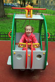 Joyful girl playing on the playground — Stock Photo