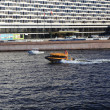 Shuttle boat speeds along the Neva River, St. Petersburg, Russia. - Stock Photo