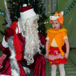 Girl in a mask squirrel poem tells Santa Claus — Stock Photo