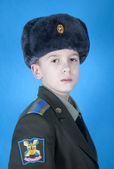 Porträtt av en pojke i uniform — Stockfoto