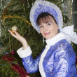 Stockfoto: Christmas tree toy in hand of Snow Maiden