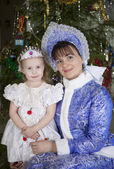 Maiden and the little girl with Christmas tree — Stock Photo