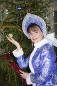 Christmas tree toy in the hand of the Snow Maiden — Stock Photo
