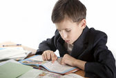 Schoolboy prepare for lessons — Stock Photo
