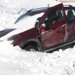 Smashed car in the snow snow — Stock Photo