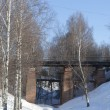 Old pedestribridge over ravine. Tot'ma, Vologdregion, Russia — Stock Photo #23314904