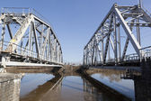 Railway bridge over the river Vologda, Russia — Stock Photo