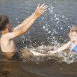 Children splashing water in the river — Stock Photo