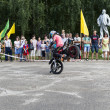 Постер, плакат: Stand on the front wheel of a motorcycle in the performance of Thomas Kalinin Verhovazhe Vologda Region Russia