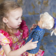 Baby girl plays with doll — Stock Photo #35506521