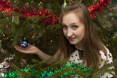 Girl holds in his hand Christmas toy — Stockfoto
