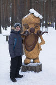 The boy at the coved sculptures Lapot Ancestral lands on Father Frost — Stock Photo