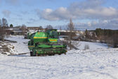 Harvester  Niva  to winter quarters of the Russian village — Stock Photo