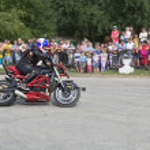 Постер, плакат: Motorcycle show in village Verkhovazhye Vologda Region Russia Alexei Kalinin motorcycle accelerates