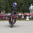 Постер, плакат: Motorcycle Show in Verkhovazhye Vologda Region Russia Alexei Kalinin raised his hands to the top and welcomes visitors