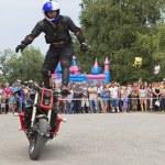 Постер, плакат: Alexei Kalinin rides standing on a motorbike Moto show in Verkhovazhye Vologda region Russia