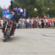 Постер, плакат: Alexei Kalinin raised his arms and welcomes visitors Moto show in Verkhovazhye Vologda region Russia