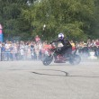 Постер, плакат: Alexei Kalinin draws on asphalt tires of his motorcycle