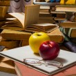 Glasses apples and books — Stock Photo