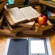 Ebook apple and open old book — Stock Photo
