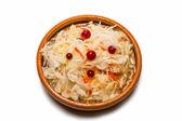Sauerkraut on clay dish — Stock Photo