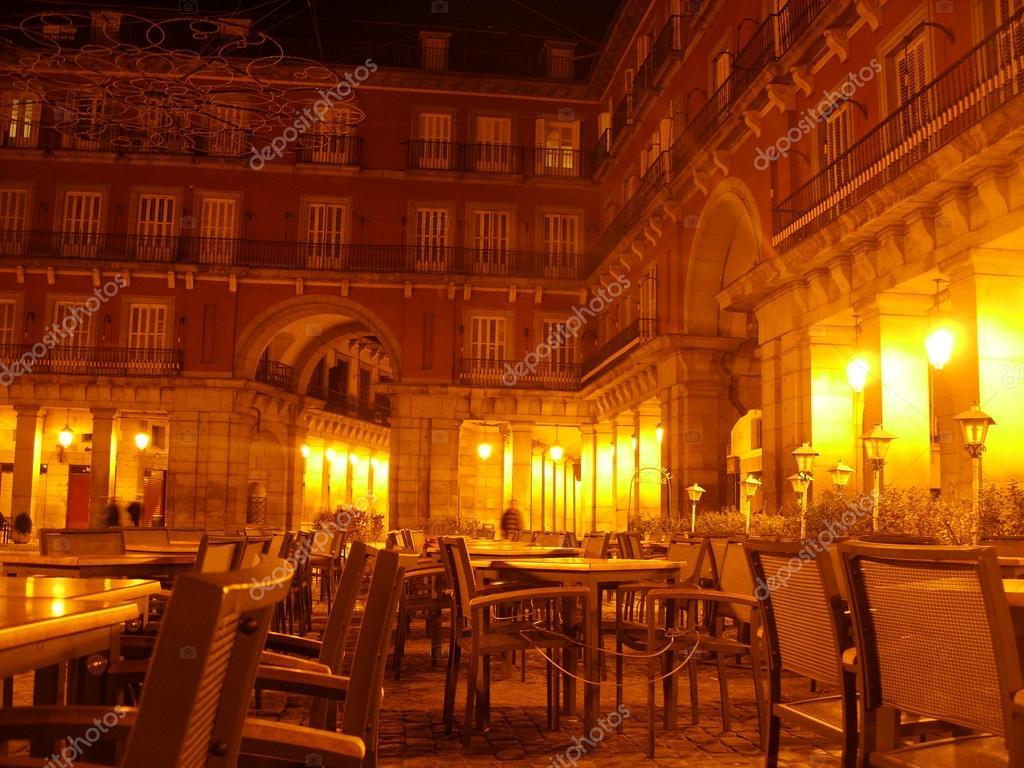 Empty cafe tables during the wee hours of the morning in Madrid&#039;s Plaza Mayor (Spain).  Stock Photo #13715882