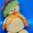 Knitted snowman on a blue background — Stock Photo
