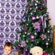Baby and teddy bear under the Christmas tree — Stock Photo