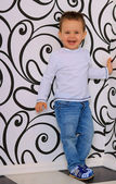 Laughing boy on a background of geometric pattern — Stock Photo