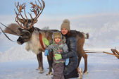 Mom and kid around with deer sled — Stock Photo