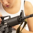 Woman with rifle — Stock Photo