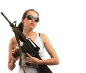 Girl with a rifle M16 — Stock fotografie