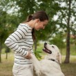 Active outdoor games, dog and girl — Stock Photo
