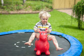 Young boy jumping in the garden — Stock Photo