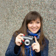 Girl with camera smiling — Stock Photo #13945221