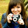Young girl with camera — Stock Photo #13945270