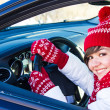 Woman driving a car in winter — Stock Photo