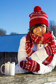 Portrait of a girl in winter with a mug of hot chocolate — Stock Photo
