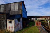 Rundown corrugated steel buildings. — Stock Photo