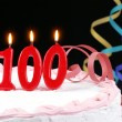 Birthday cake with red candles showing Nr. 100 - Foto Stock
