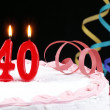 Stock Photo: Birthday cake with red candles showing Nr. 40