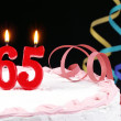 Birthday cake with red candles showing Nr. 65 — Stock Photo #13703411