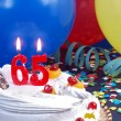 Birthday cake with red candles showing Nr. 65 — Stock Photo #13706473