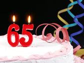 Birthday cake with red candles showing Nr. 65 — Stock Photo